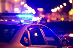 blue police light at night | Do Warmer Winters Cause More Violent Crime?