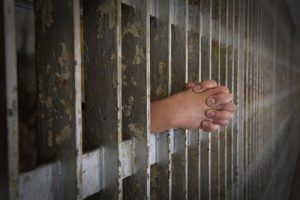 Hands-of-Prisoner-Coming-from-old-Cell-Repeat DUI Offender in Colorado gets Prison Time
