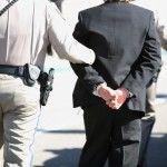 Man-in-Cuffs-with-cop