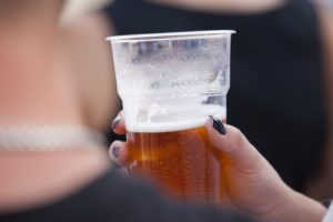 woman holding plastic beer cup | women in boulder have reported being Drugged at Parties