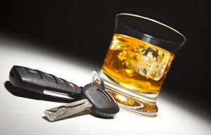 Alcoholic Drink and Car Keys Under Spot Light | Felony DUI Law Goes Into Effect in Colorado