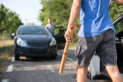 driver approaching another driver while carrying a bat   road rage in boulder