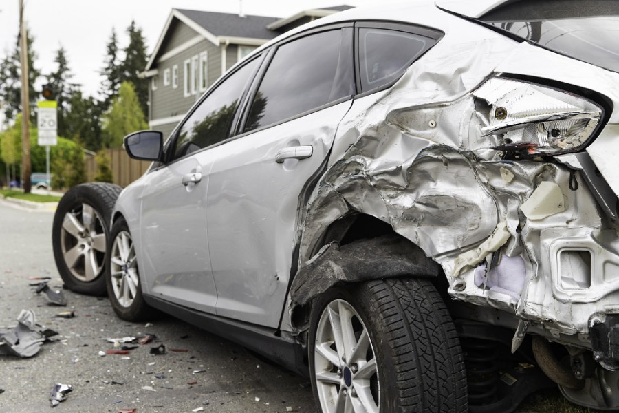 Car damaged after colliding with another car | Colorado Man Convicted in Fatal Drunk Driving Crash