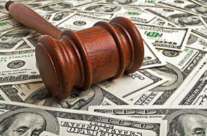 Wooden gavel and American dollars | how does bail work