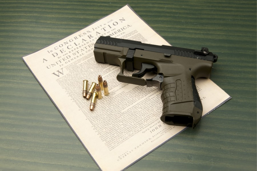 gun with bullets on top of a certificate | Getting Your Gun Rights Back after a Felony Conviction