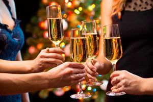 Women's hands with crystal glasses of champagne | New Year's DUI