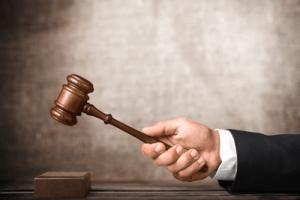 Judge banging a gavel | Boulder Municipal Code Title V Chapter 1