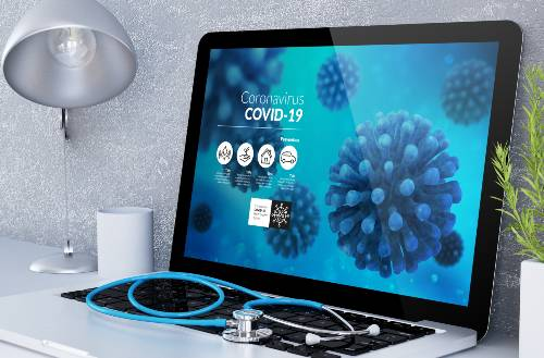 laptop with information about the COVID 19 | coronavirus on criminal court cases