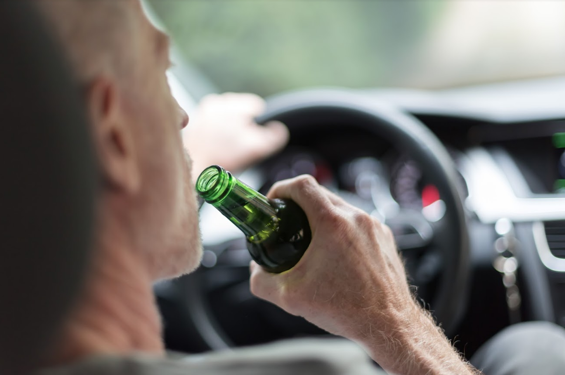 man drinking beer while driving | dui administrative consequences
