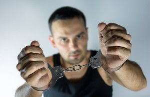 man holding up cuff hands | Colorado Misdemeanor Charges