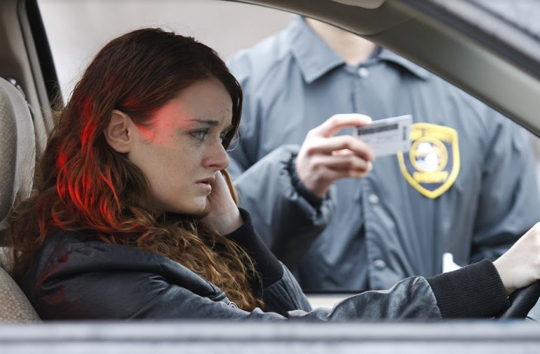 woman worried as police is checking her driver's license | MIRANDA RIGHTS IN A DUI STOP