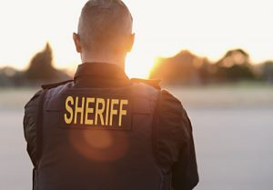 back of sheriff looking at the sunset | America's Faulty Perception of Crime Rates
