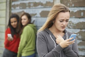 Teenage Girl Being Bullied By Text Message | Cyberbullying in Colorado is Now a Misdemeanor