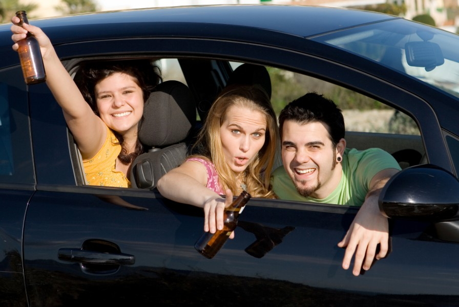 teenagers drinking on a car | penalties for underage drinking in boulder