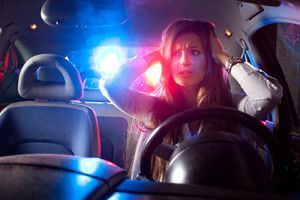 Police car in pursuit | DUI charges resulting in injury or property damage